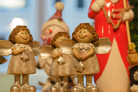 Figurines of golden angels on the shelf. Archivio Fotografico