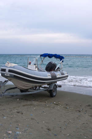 Rubber inflatable boat on the seashore.