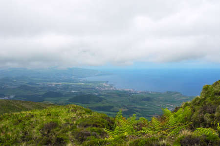 Gray rain clouds over hills and lakes in Sao Miguel island. Travel to the Azores. Reklamní fotografie