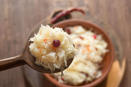 Sauerkraut with cranberries close-up. Fermented vegetables. Super product for proper nutrition. Closeup.