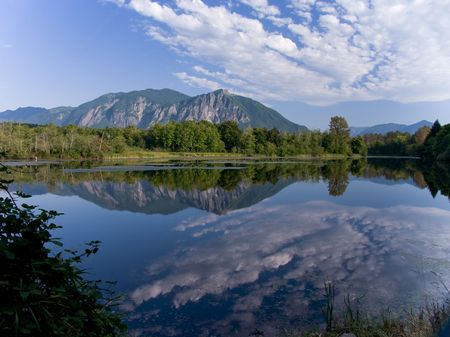 Mt. Si reflected in Weyehauser Mill Pond Stock Photo