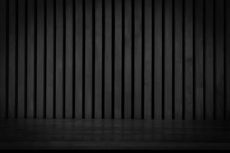 Black wooden board empty table in front of dark wood wall. Black wooden plank shelf on wood wall texture background.