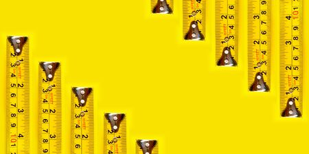 Frame yellow measuring tape on yellow background and texture. 版權商用圖片