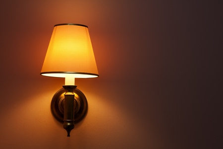 one yellow lamp on white wall Stock Photo - 11760194