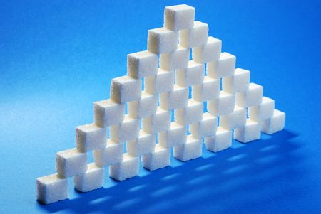 to refine: Sugar cube refined on a blue background