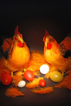 Hen, cock and eggs in easter decorations. photo