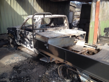 bush fire: Burnt out car in bush fire