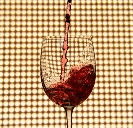 pouring red wine photo