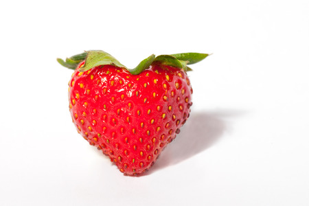 health symbols metaphors: A red juicy strawberry shaped as heart