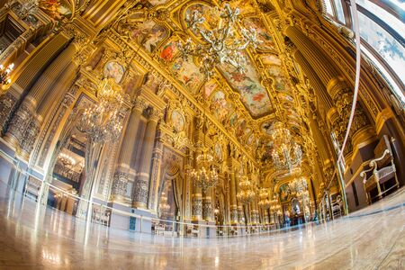 Paris, France - October 2017: Grand foyer inside of the Palais Garnier Opera Garnier in Paris, France. Its ceiling by Paul-Jacques-Aim Baudry and represents moments in the history of music. 新聞圖片