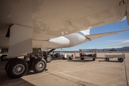A big civil airplane standing on a tarmac at the airport.