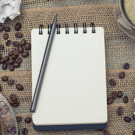All set for artist: a notebook with a pencil plus coffee and don