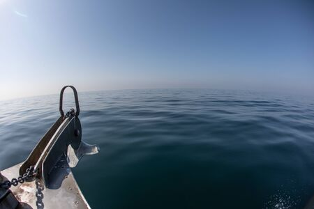 A bow of a boat on a calm ocean surface on a clear day Stok Fotoğraf - 130060970