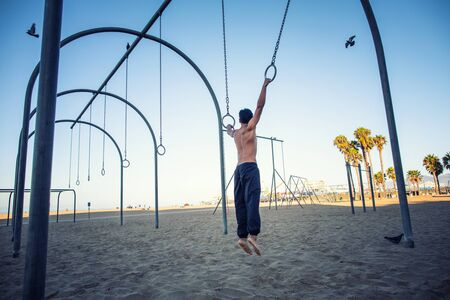 people exercising and relaxing at muscle beach jungle gym on 2017-03-31 in Santa Monica, California, USA