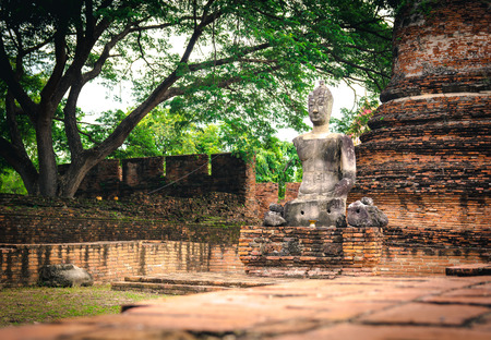 The old buddha statue was broken and placed in old temple in Thailand