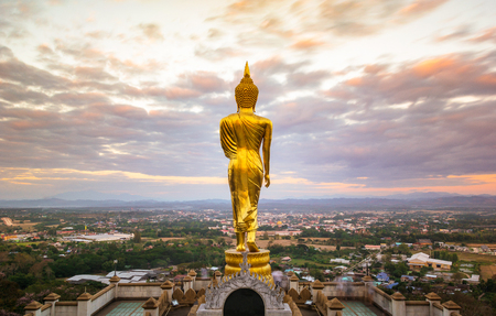 Back side of buddha statue that placed on top of Khao Noi hill in Nan province, Thailand Reklamní fotografie