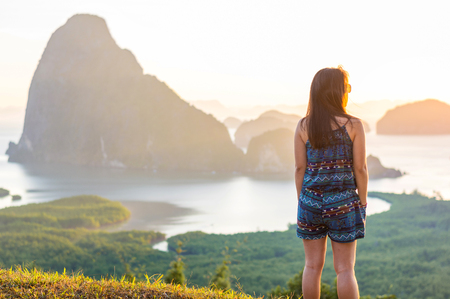 Woman stand on top of hill and looking view of Phang Nga Bay from Samed Nang Chee