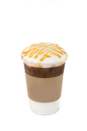 Ice coffee topping with caramel sauce in plastic cup and paper label