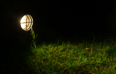 Light from lamp project on the field around with dark Reklamní fotografie