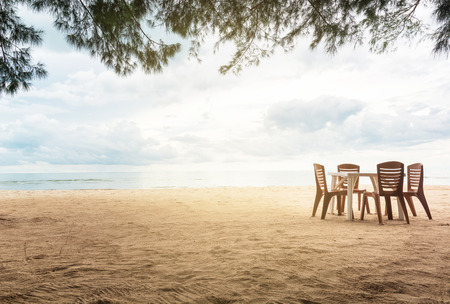 Seascape with table and chair in cloudy day at Thailand Reklamní fotografie