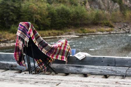 Rest with a book on wooden bridge on natural background Stock Photo