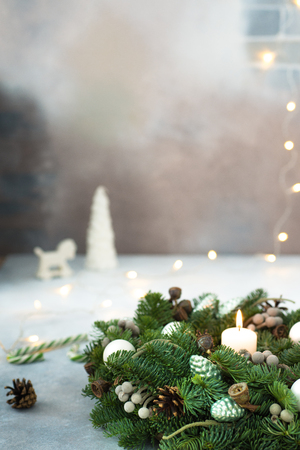 Christmas or new year background with copy space. Christmas wreath and toys, candy cane, christmas lights.
