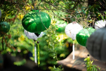 Beautiful white and green lanterns in soft and blur style in Hoi An, Vietnam.