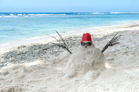 Snowman made of white sand instead of snow. Imagens