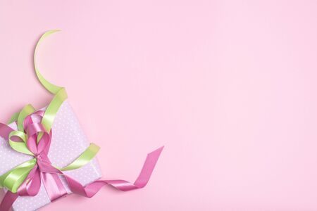 Pink gift box with ribbons. Holiday concept.
