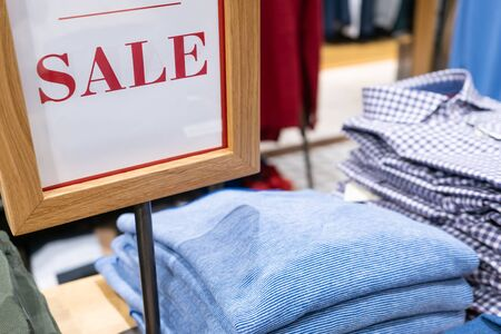 Shopping sale background. Sale sign in a men's clothing store.