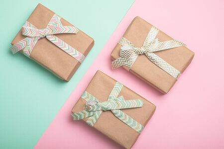 Gift boxes with ribbons on duo tone background. Фото со стока