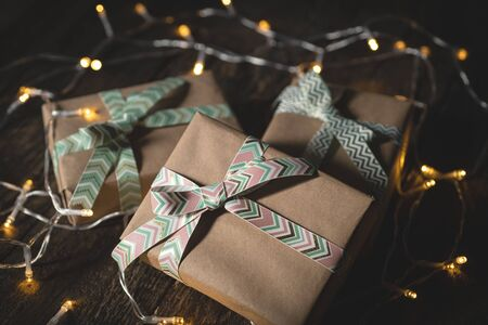 Gift boxes with ribbons on wooden