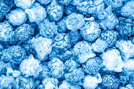 Blue candy popcorn background. Top view. Фото со стока