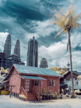 kampung: A traditional house with twin tower background located at Kampung Baru Kuala Lumpur Malaysia. Stock Photo
