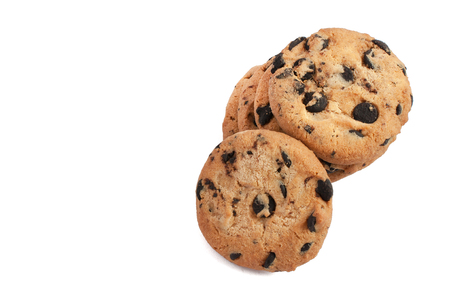 brocken: delicious cookies with chocolate stacked in a pile and photographed from above on a white background
