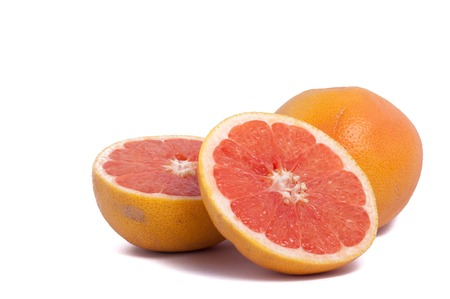 two and a half: red grapefruit one whole and two half isolated on white background Stock Photo