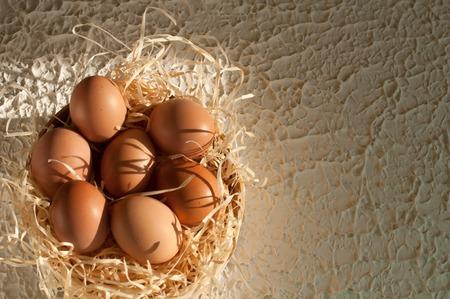 basketful: Easter holiday. sieve full of easter eggs on rustic wood