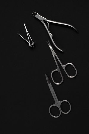 scissors: set of metallic manicure tools on a black background.