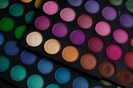 Palette of professional colorful eye shadows. Collection of multicolor eyeshadows. Cosmetology product. Makeup set background. Stock Photo