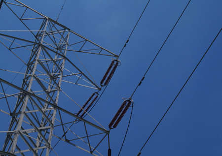 Close-up of large power lines against dark blue sky Imagens - 14955142