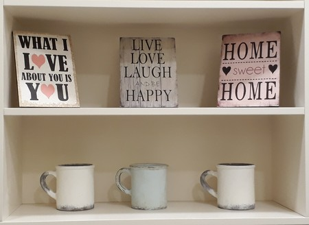 Decorative Inspiring Shelf With Mugs And Signs For Home Stock Photo Cool Decorative Inspirational Signs