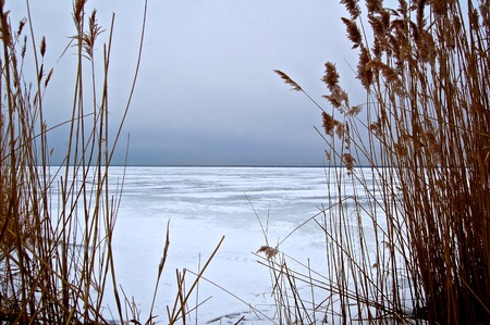 unoccupied: Peering Out onto the Frozen Bay Stock Photo