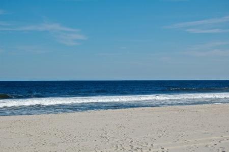 waves crashing: Sunny beach day, waves crashing and blue skies