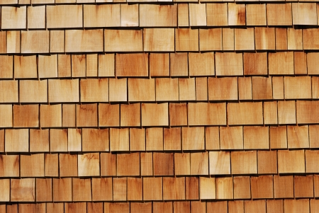 roof shingles: Wood tiled background showing close-up detail.