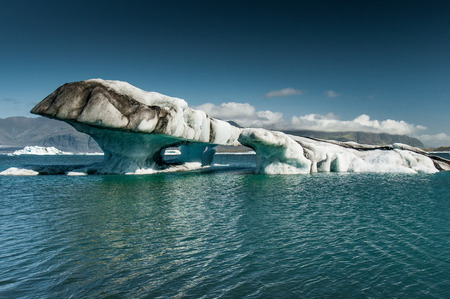 Groups of icebergs drift on the lake lagoon formed by the melting of the Jokulsarlon glacier Stock Photo