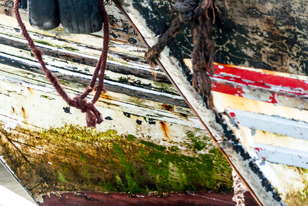 Close up on the hulls of fishing boats anchored in the port of Essaouira in Morocco