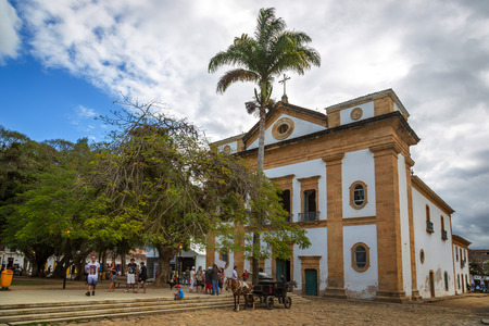 Paraty, Rio de Janeiro - January 24th 2012 - Tourists around the main cathedral of Paraty city in south shore of Rio de Janeiro state in Brazil.