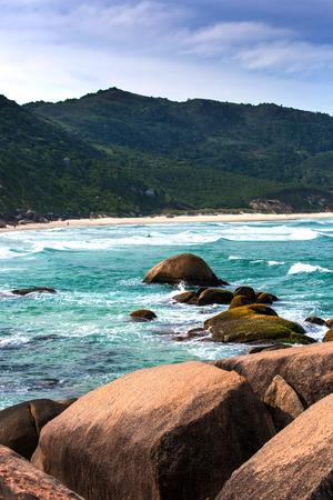 Beautiful blue water and sky in Praia Mole (Praia Mole) in Florianopolis, Santa Catarina, Brazil. One of the main tourist destination in south region. Stock Photo