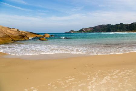 Beautiful blue water and sky in Praia Mole (Praia Mole) in Florianopolis, Santa Catarina, Brazil.