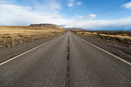 Empty road in El Calafate with a snow mountain, Patagonia Argentina Stock Photo